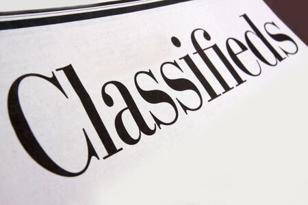 classifieds: Newspaper classifieds section Stock Photo