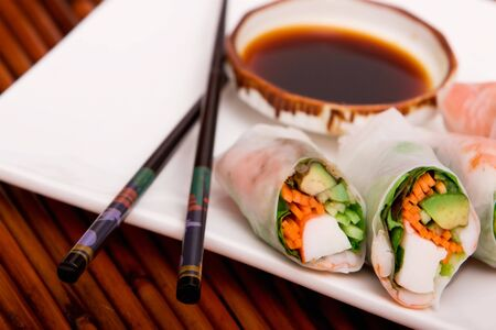 Spring rolls served with soy sauce