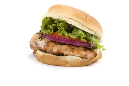 Healthy grilled chicken sandwich with lettuce, tomato and onion