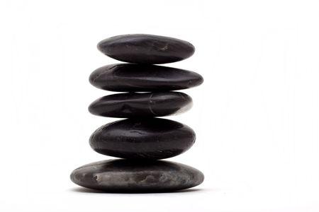 lastone: Stack of lastone therapy rocks on white background