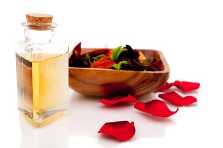 Aromatherapy oils with potpourri on white background