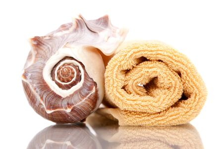 Stack of bath towels and seashell