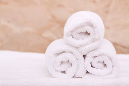 Rolled up white bath or spa towels