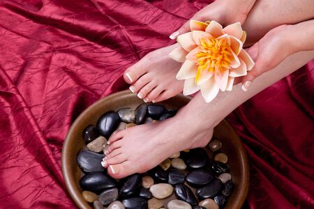 Hands and feet of a female being pampered photo