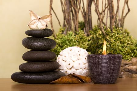 Massage stones and spa candle Stock Photo