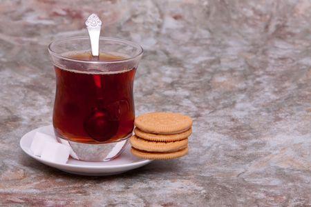 Glass of tea and cookies
