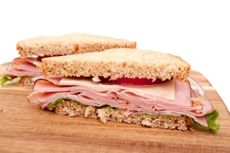 Delicious ham sandwich with whole wheat bread cut in half photo