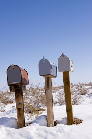 Mailboxes in snowy desert