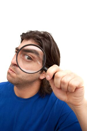 curious: Curious man holding a magnifying glass