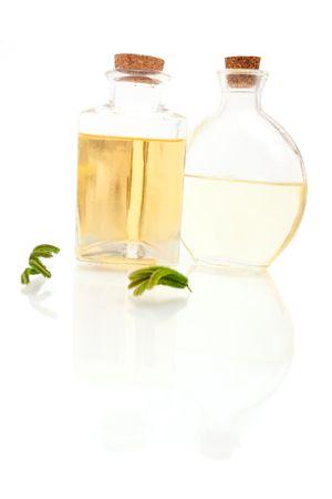Aromatherapy oils on white background