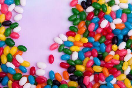 Multi colored vibrant jellybean candies Imagens
