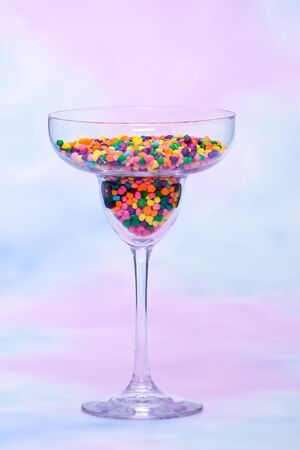 margarita glass: Margarita glass filled with colorful candy Stock Photo