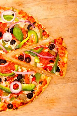 bell peppers: Pizza with pepperoni, bell peppers, black olives and onions