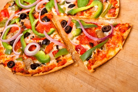 Pizza with pepperoni, bell peppers, black olives and onions