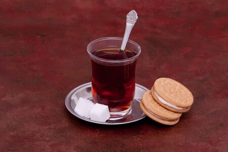 Glass of tea and cookies