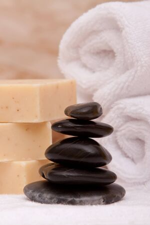 lastone therapy: Stack of lastone therapy rocks with towels and soap