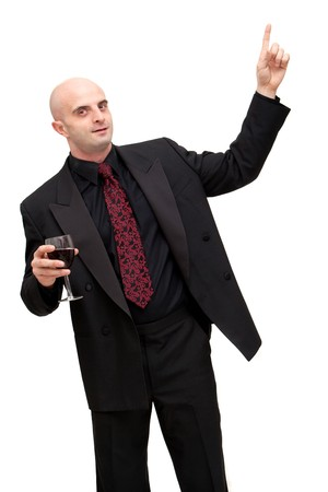 Young business man in dark suit holding a glass of wine