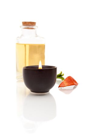 Aromatherapy oils and candle on white background Reklamní fotografie