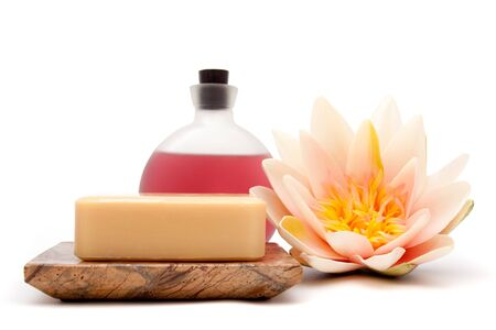 Essential oils, soap and waterlily for spa decor Фото со стока