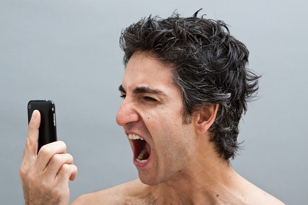 Angry man screaming on his cell phone Stock Photo - 7018262