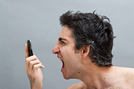 Angry man screaming on his cell phone Stock Photo - 7118080