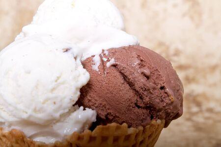 Chocolate and vanilla ice cream in a cone