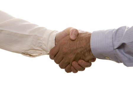 Businesspeople shaking hands upon an agreement