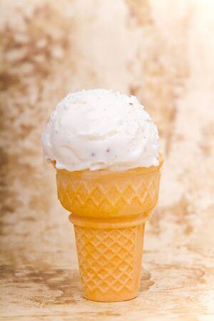 Scoop of vanilla ice cream in ice cream cone Reklamní fotografie