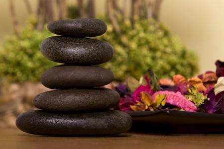 Massage stones with a bowl of potpourri Banco de Imagens