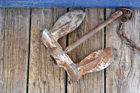 boat dock: Rusty anchor of a boat