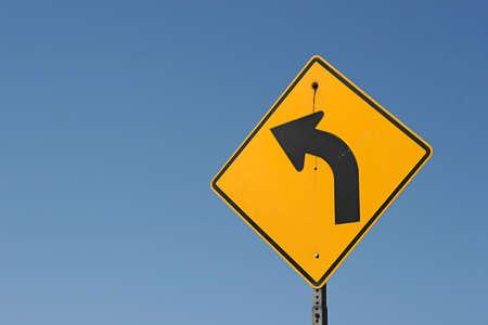 Left turn traffic or road sign Stock fotó