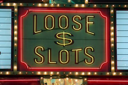 Bright neon loose slots sign