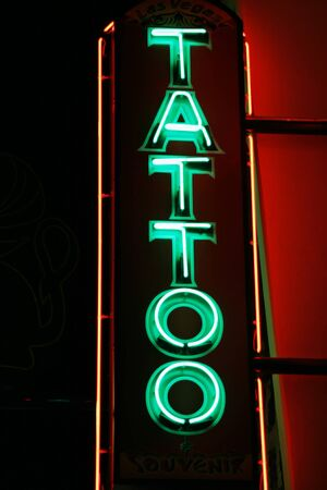 Neon tattoo parlor entrance sign