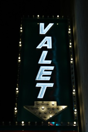 valet: Neon valet park sign at the garage