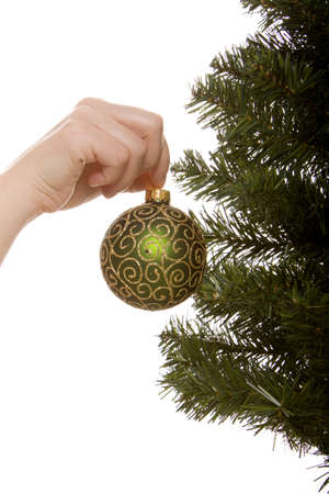 decorating christmas tree: Decorating a Christmas tree with ornaments