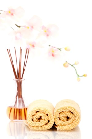massage oil: Massage oil and towels with orchid background Stock Photo