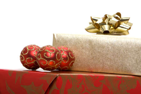 Christmas presents with ornaments on white background