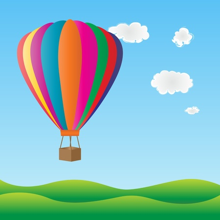Hot air balloon flying over green hills