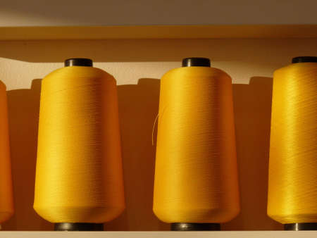 acrylic yarn: Yellow bobbins