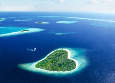 oasis at sunrise: Maldivian island in the shape of heart