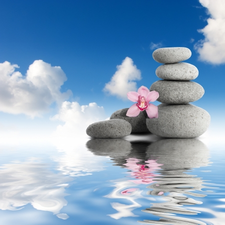 Gray stones and orchid sky with clouds photo