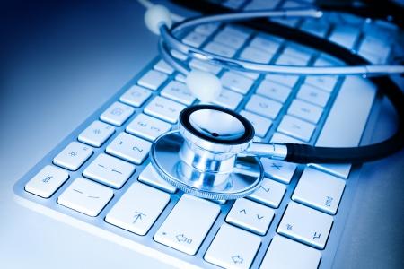 personal information: stethoscope on keyboard