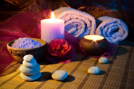 two candles towels camellias stones and salt  photo