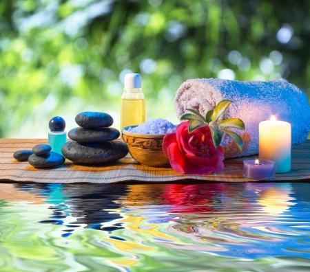 camellia: stones, candle camellia oil salt towel on water