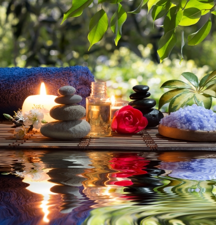 blackwhite: two candles and towels black-white stones and almond blossom on water Stock Photo