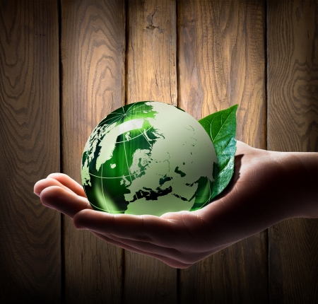 new beginnings: green world in the hand Stock Photo
