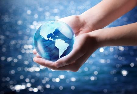 terrestrial: blue world in the heart hand