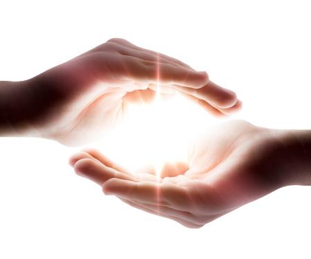 manos: luz en sus manos Foto de archivo