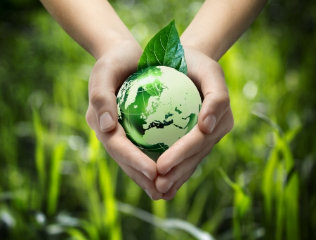 equitable: green world in the heart hand - grass background