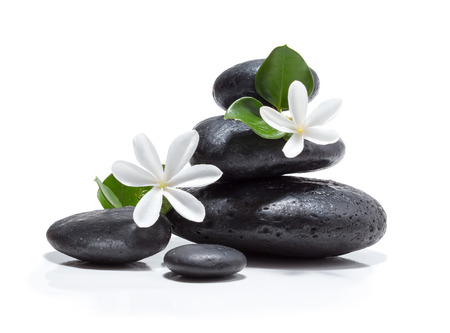 zen: tiare flowers, candle and black stone spa